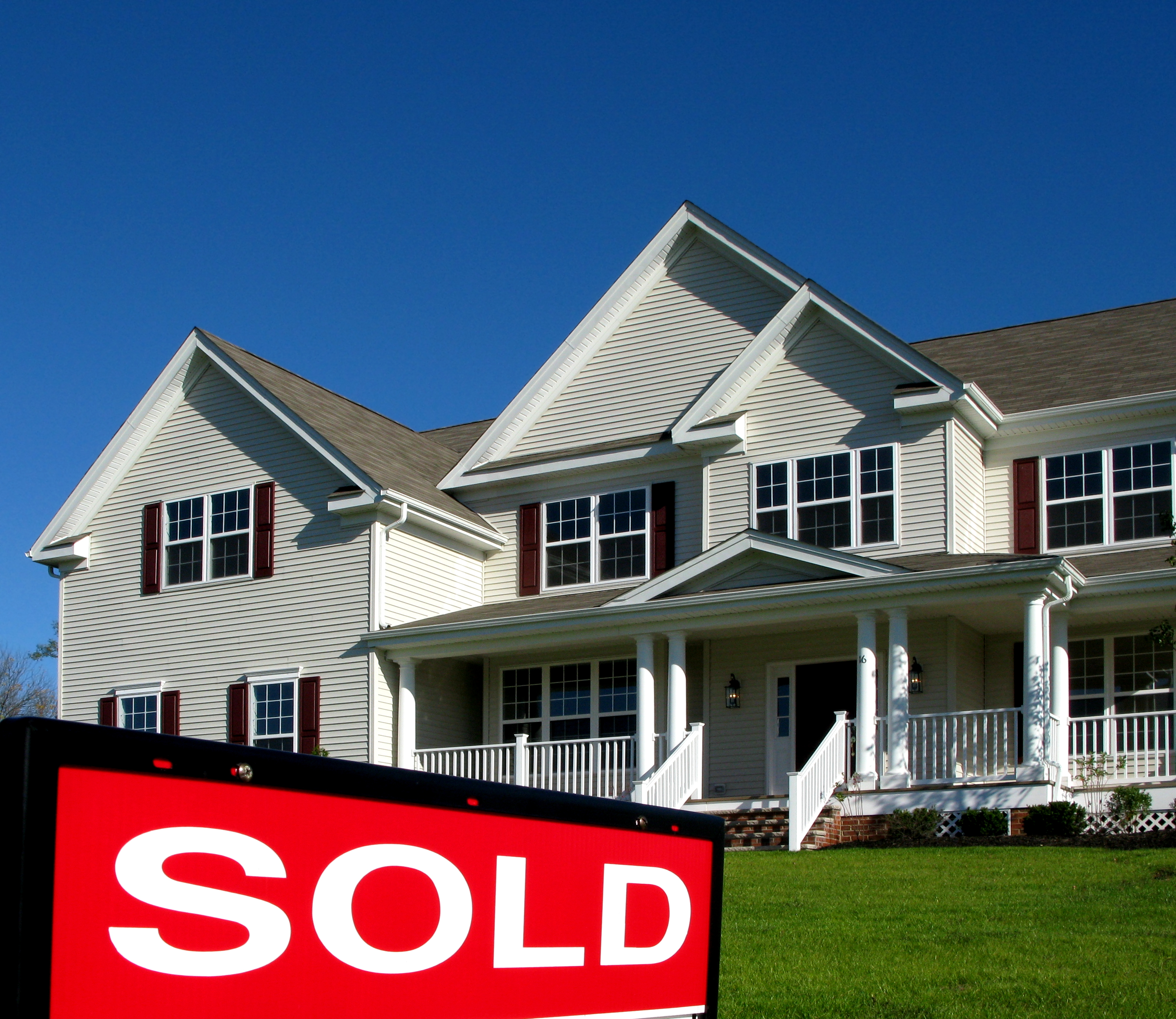 bigstock Real Estate Sold Sign and Hous 2302124